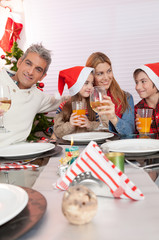 Happy family of four at Christmas table