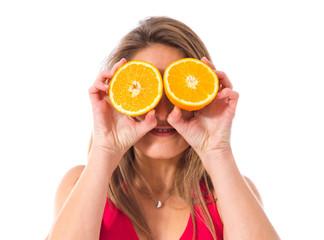 Sport woman holding an orange