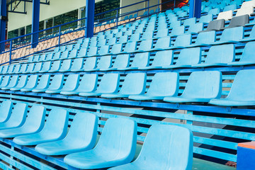 Sport stadium chair on bleachers