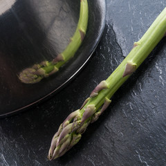 Green asparagus in the pot