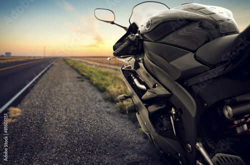 Motorbike on an empty road at sunset