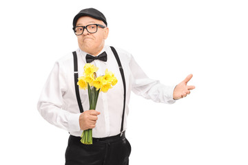 Confused senior gentleman holding flowers