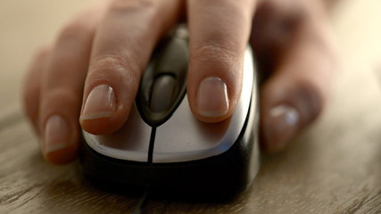 Woman click on Computer mouse