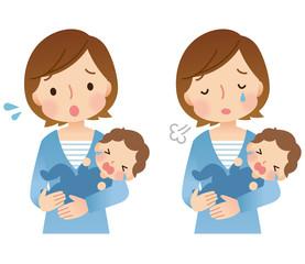 泣いている赤ちゃんと母親