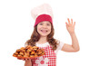 happy little girl cook with bruschette and ok hand sign