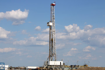 land oil drilling rig on field