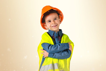 child dressed as a workman with his arms crossed