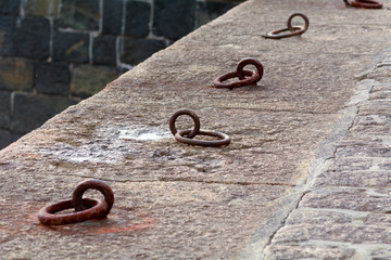 Mooring rings on Mullion harbour wall, Cornwall, England