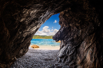 Crystal clear sea from inside a cave ( focus is on the sea )