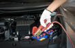 automotive technician charging vehicle battery - 81606729