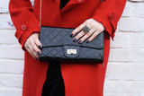Fashionable woman with  stylish black clutch , accessories