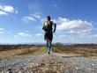 Zdjęcia na płótnie, fototapety, obrazy : Male runner on long country trail