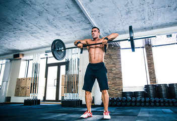 Muscular man lifting barbell