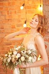 Tender beauty portrait of bride with flowers bouquet