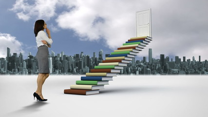 Businesswoman looking at stair made of books in front of a city
