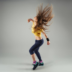 Young energetic zumba fitness woman dancer moving in class