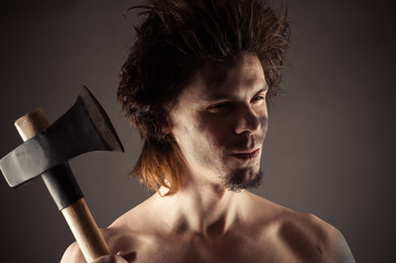 portrait of unshaven man with an ax in hand