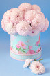 pink chrysanthemum flowers in a beautiful box. blue background.