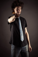 young businessman showing finger