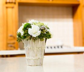 Beautiful bouquet of white flowers in basket