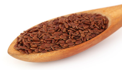 Flax seeds in wooden spoon
