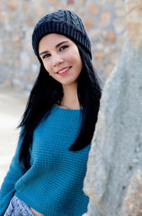 Cool smiling girl with wool cap