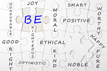 BE concept written on white puzzle, jigsaw