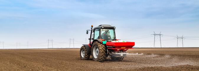 Farmer fertilizing arable land with npk fertilizer