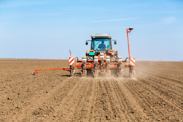 Farmer seeding soybeans