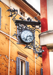 street clock as decorative element in Bologna