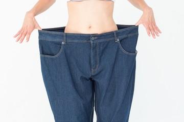 Woman wearing too large pants