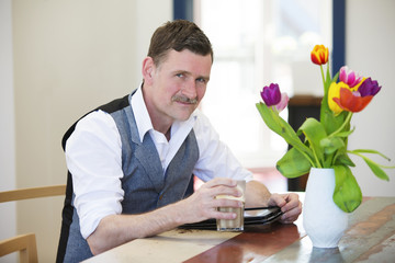 man with a coffee and a notepad