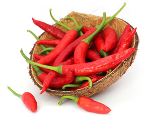 Red chili peppers in a coconut shell