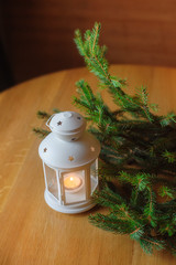 Beautiful white candlestick in the form of a small house and a s