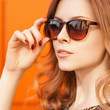 Closeup summer portrait of young beautiful woman in sunglasses.