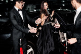 Fototapety Friends near the car. Hollywood star. Celebrating.