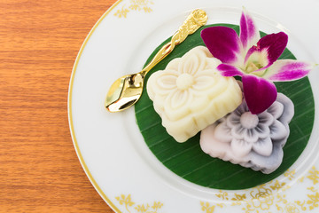 Japanese Cake with Golden Spoon and Orchid