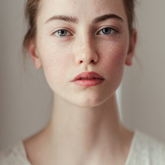 Morning portrait of a beautiful young girl with freckles