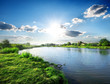 Leinwandbild Motiv Sun over river