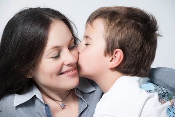 Happy mother with the son isolated on light background