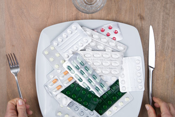 A Pills on a plate as food supplement