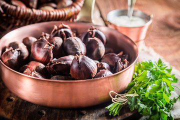 Closeup of fresh chestnuts. with parsley