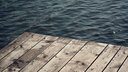 Old Wooden Pier Jetty and Metal Ladder on River, Water Sparkling