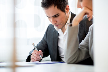 Young couple checking a document or contract