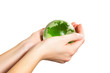 Holding green Earth in hand