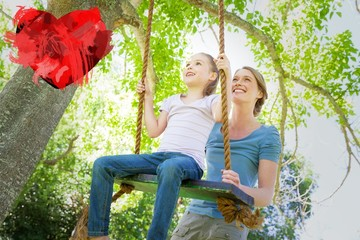 Composite image of happy mother swinging daughter at park