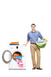 Young man standing by a washing machine