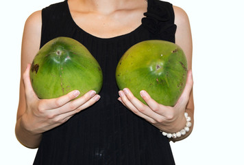 breast woman holding coconut implant female surgery concept