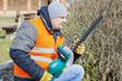 Landscape worker check bush cutter