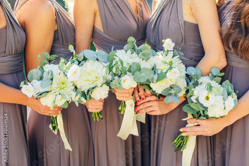 bridesmaids in brown with wedding bouquet - 81619524
